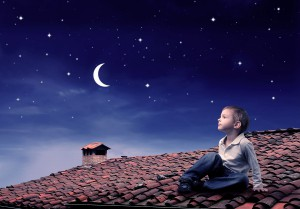 bigstock-Child-sitting-on-a-rooftop-and-12160391-300x209